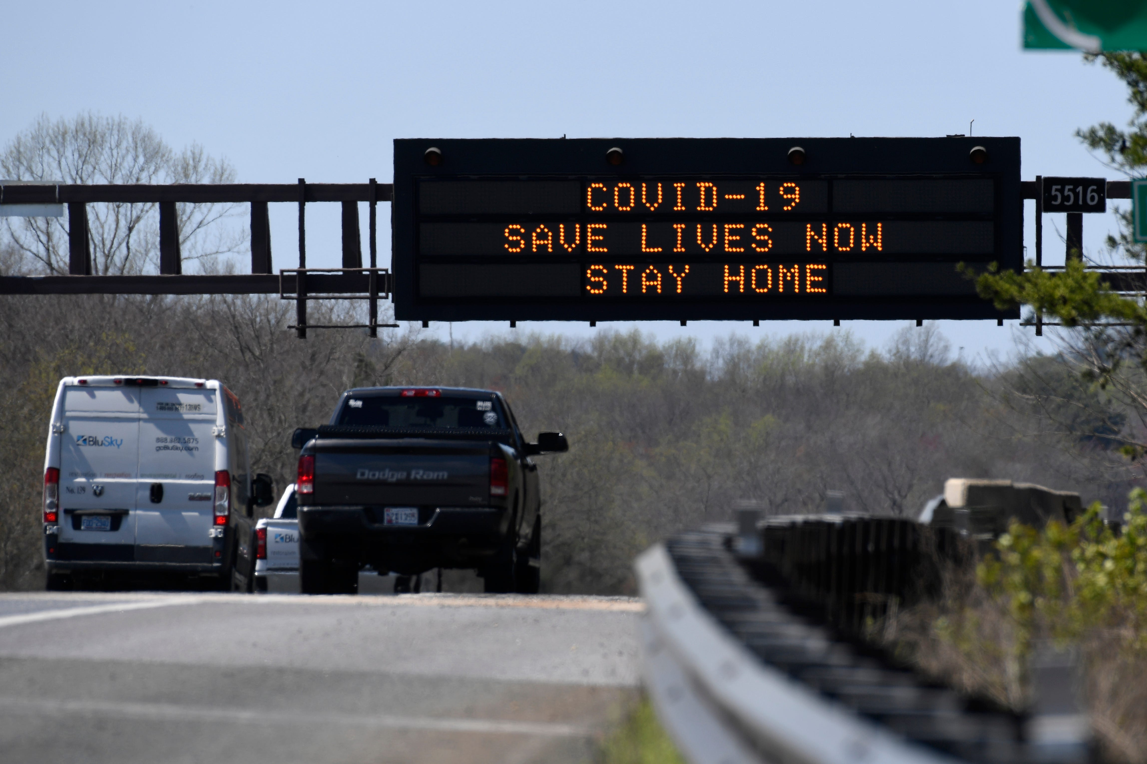 """A sign about the coronavirus is displayed over Route 50 in Davidsonville, Md., on Monday, March 30, 2020. Maryland Gov. Larry Hogan issued a """"stay-at-home"""" directive in response to the coronavirus effect on Monday. """"No Maryland resident should be leaving their home unless it is for an essential job or for an essential reason, such as obtaining food or medicine, seeking urgent medical attention or for other necessary purposes,"""" Hogan said at a news conference on the Maryland State House lawn."""