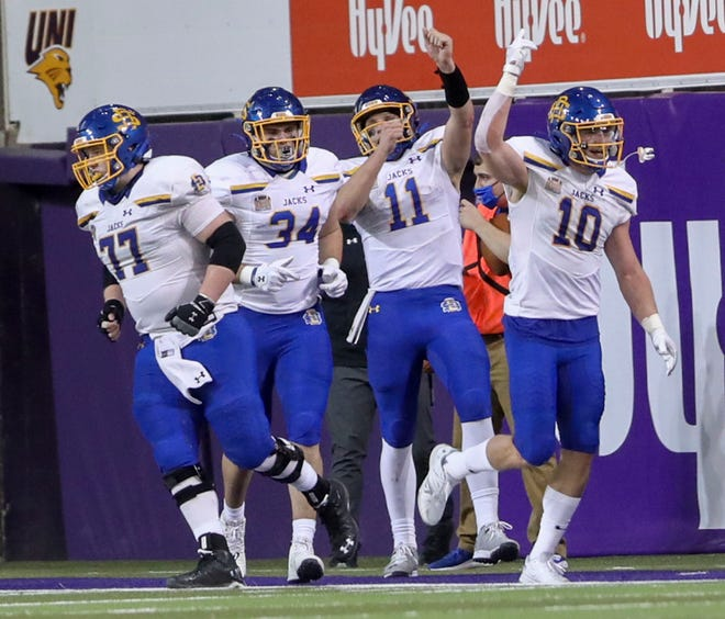 South Dakota State Jackrabbits players celebrate a touchdown in the second quarter at a Northern Iowa Panthers football game with the South Dakota State Jackrabbits at the UNI-Dome in Cedar Falls on Friday, Feb. 19, 2021.  (Rebecca F. Miller/The Gazette)