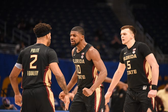 Anthony Polite, Malik Osborne and Balsa Kopricia celebrate a made shot during the Seminoles' win over Pittsburgh on Feb. 20, 2021.