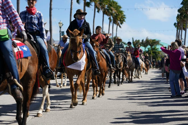 Whether on the street or down a country road, motor vehicles must give the right of way to horses and other livestock. Safety first means slow or stop until the riders have passed by.