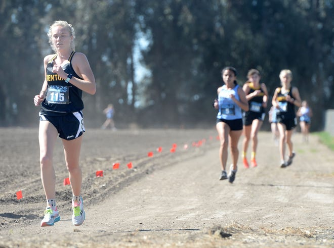 Taylor Sovich of Ventura High takes the lead in a meet against Buena High on Saturday, Feb. 20, 2021, at Oxnard High School. It was the first Pacific View League cross country meet for both schools since the pandemic shut down high school sports last March. Sovich won the girls varsity race in 19:35.