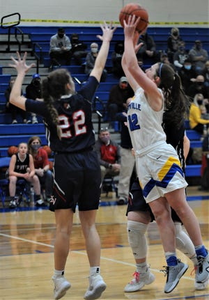 Maysville's Averee Vaughn goes up for a shot against Indian Valley's Ashton Doak in Saturday's Division II sectional final. The Panthers won 50-30.