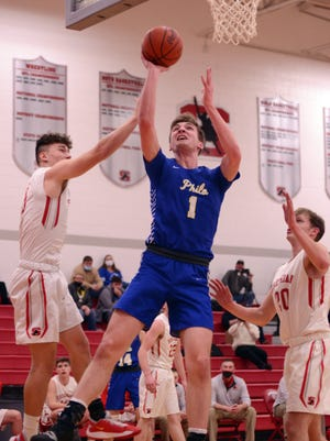 Philo's A.J. Clayton scores down low in a game against Sheridan this season. Clayton was voted second team All-Ohio in Division II on Tuesday.