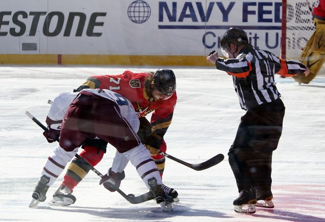 Vegas Golden Knights center William Karlsson (71) takes a face off against Colorado Avalanche center Nathan MacKinnon (29) in the first period of a NHL Outdoors  game.