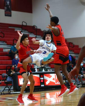 Albert Garza falls away for a buzzer beater for the McCallum Knights to end the first quarter against Manor in a Class 5A bidistrict matchup Saturday at Weiss High School. McCallum defeated Manor by a final of 56-39 to snap a long playoff victory drought.