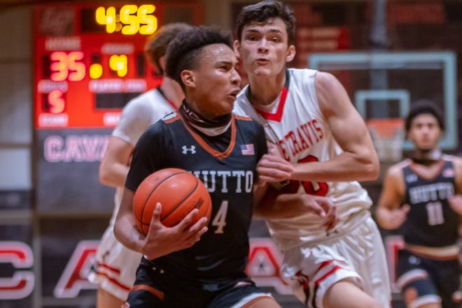 Hutto Hippos guard Kaden Smart, left, is fouled by Lake Travis Cavaliers forward Braden Goldsmith in a nondistrict game in December that Hutto won 92-45. The two teams will meet again Tuesday in a Class 6A bidistrict playoff game.