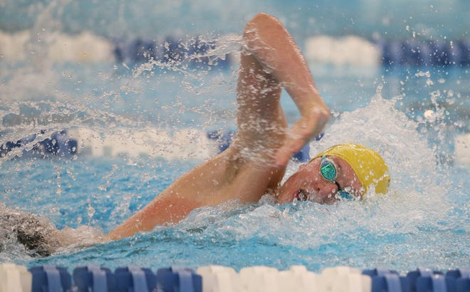 Firestone sophomore Jonny Marshall qualified for the U.S. Olympic Trials in the 100-meter backstroke during the USA Speedo sectional meet in Indianapolis over the weekend. [Mike Cardew/Beacon Journal]