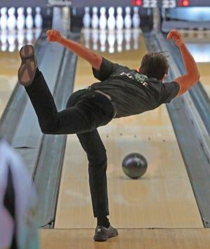 Dylan Esterle of Highland follows through on a roll during the boys Division I District Bowling tournament Sunday at Stonehenge Bowling Center. Esterle advanced to the state tournament as an individual. [Phil Masturzo/Beacon Journal]
