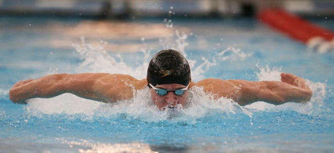 Hoover's TJ Bragg swims the butterfly leg of the boys 200 yard medley relay at Northeast District Division I Championships at the SPIRE Institute on Saturday Feb. 20, 2021. The Hoover relay won the event.