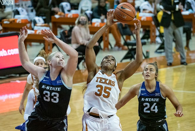 Texas' Charli Collier pulls down a rebound against Kansas State players Ashley Ray and Emilee Ebert during the first half of Sunday's Longhorns win. Collier scored 21 points and and snagged 14 rebounds.
