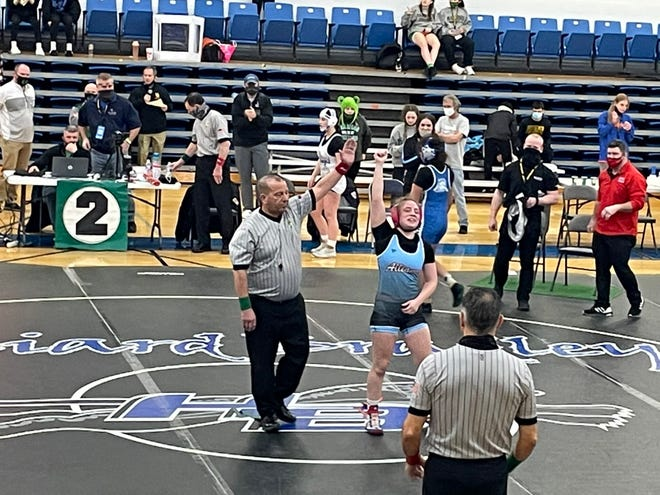 Alliance's Mallory Chunat has her hand raised by the referee after winning the 126-pound state championship at the Ohio Wrestling Coaches Association state tournament in Hillard on Saturday. Chunat won four matches, including two by pin and one by major decision, and she defeated Carmela Castaneda of Defiance 3-0 in the championship match.