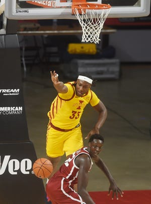 Iowa State's Solomon Young drives for the loose ball around Oklahoma's Kur Kuath during the second half at Hilton Coliseum Saturday, Feb. 20, 2021, in Ames, Iowa.