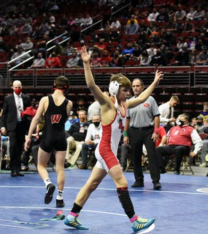 Roland-Story's Kade Blume raises his hands in triumph after beating Williamsburg's Gavin Jensen by sudden victory, 6-4, in the Class 2A 106-pound championship match at the state wrestling tournament Saturday in Des Moines.