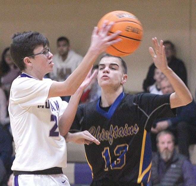 Wesleyan Christian School's Brady Rucker, left, delivers a pass during action this season.