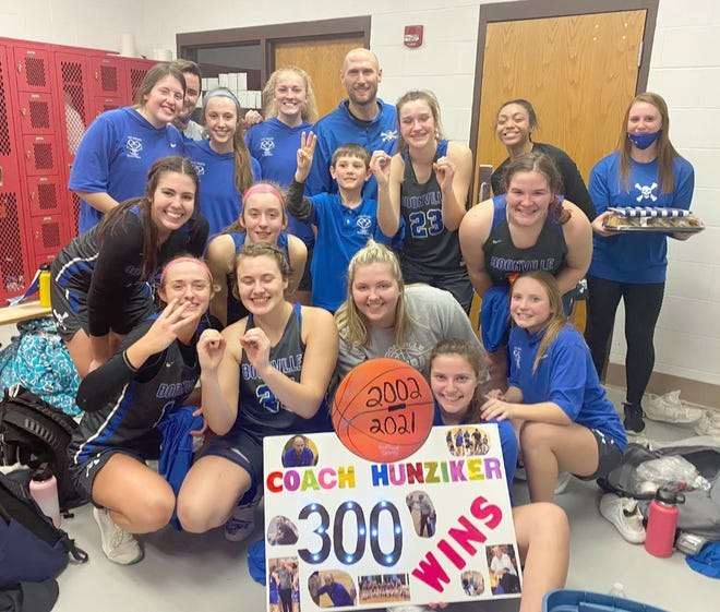 Members of the Boonville Lady Pirates basketball team celebrate head coach Jaryt Hunziker's 300th career win Friday night after beating Southern Boone 58-46 in Ashland.