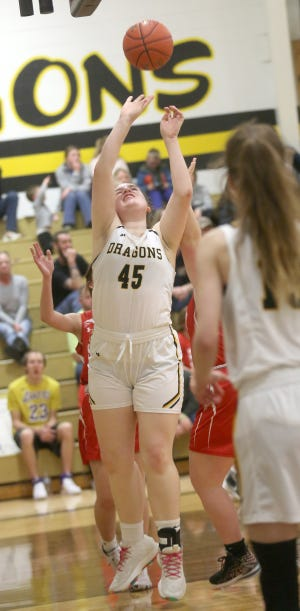 Bunceton's Maddie Brandes puts up a shot near the basket in the fourth quarter Saturday against Sedalia Sacred Heart in the opening round of the Class 1 District 9 Tournament in Bunceton.