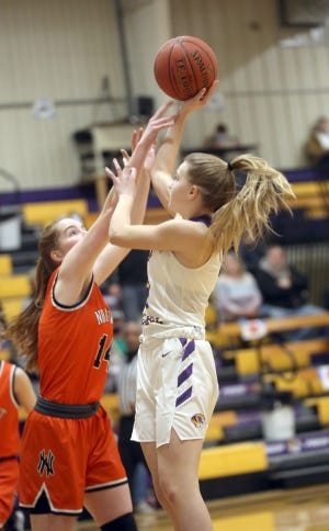 Pilot Grove's Marci Lammers shoots over a Northwest player in the first half Saturday in the opening round of the Class 1 District 9 Tournament in Pilot Grove.