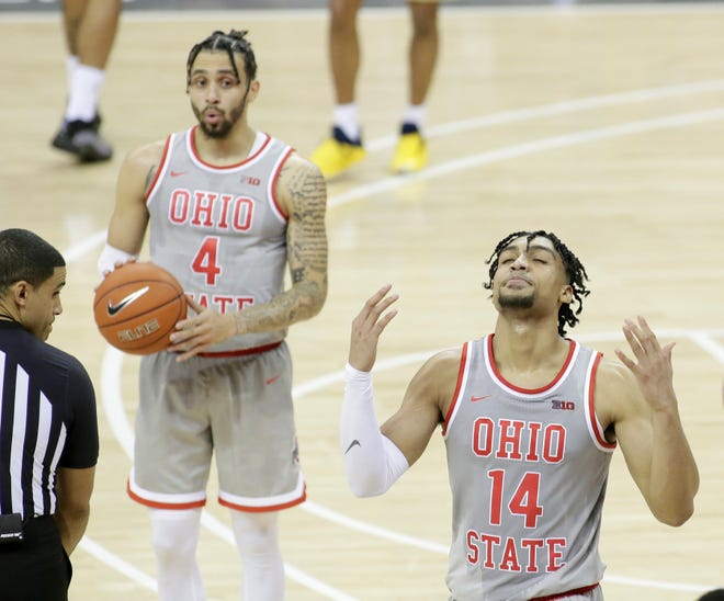 Ohio State's Duane Washington Jr. (4) and Justice Sueing react after a foul was called on Sueing during Sunday's game at Value City Arena.