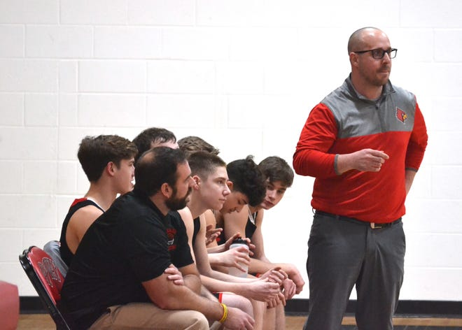 Onaway boys basketball coach Eddy Szymoniak looks on during a district game from last season. Szymoniak and the Cardinals picked up a 59-57 victory at Rogers City on Saturday.
