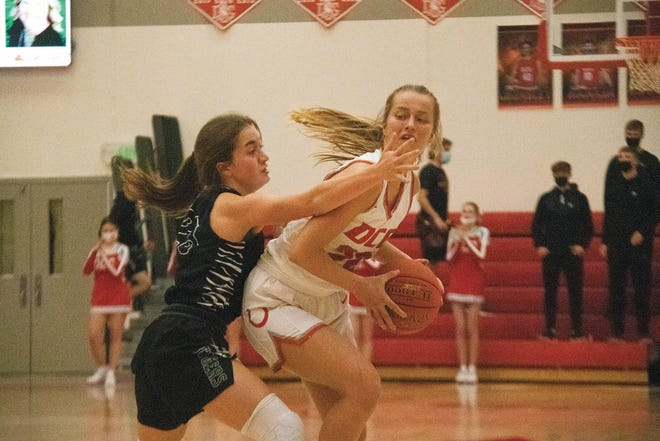 DCG's Julia Reis looks to move the ball past an ADM defender during the regional semifinal on Saturday, Feb. 20.