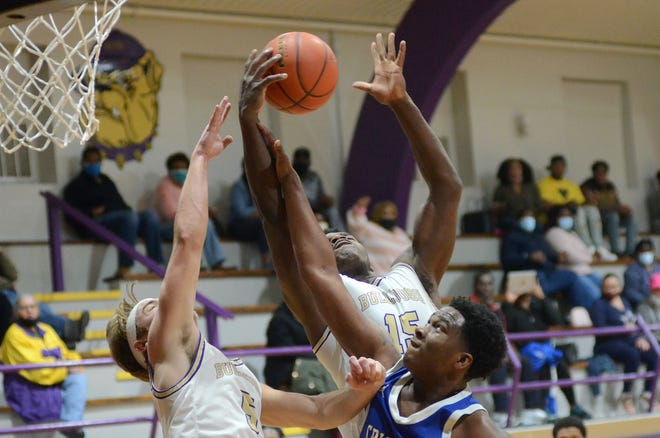 Ascension Catholic's J'mond Tapp and senior teammate Gage Breaux battle for the ball against Cristo Rey Feb. 19 in Donaldsonville.
