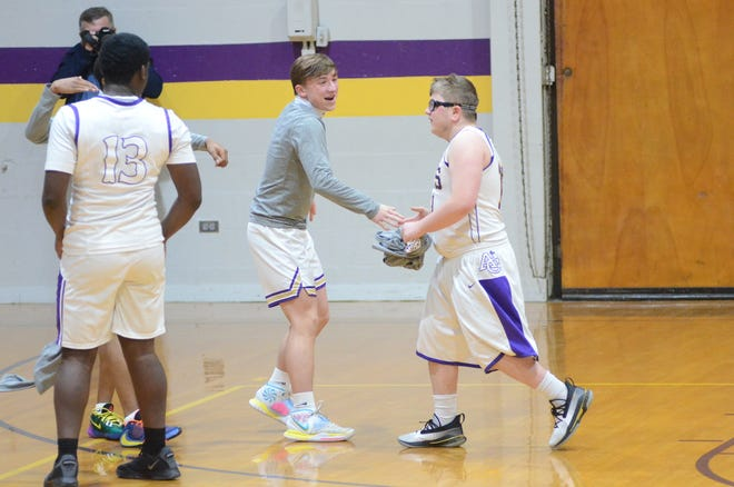 Preston Williams hit a 3-pointer from the top of the key sending the crowd into a frenzy during the junior varsity game. Teammates, including Gavin Richardson, congratulate him.