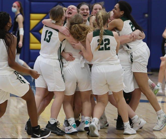 West Burlington High School's players celebrate  their Class 3A regional victory over West Liberty High School, Saturday Feb. 20, 2021 at Wapello High School. West Burlington won 47-45.