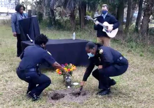 Members of the Jacksonville Sheriff's Office joined residents and community leaders who participated in the Soil Collection Ceremony remembering Willie Washington, a Black Jacksonville man whose corpse was put on display for curiosity seekers after he was the victim of a racial terror lynching in 1925.