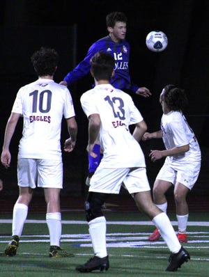 Bolles midfielder Gage White (12) rises above the Episcopal defense to win a header during a Florida High School Athletic Association Region 1-3A boys soccer semifinal on February 20, 2021. [Clayton Freeman/Florida Times-Union]