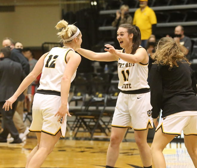 FHSU's Madison Mittie, left, and Jaden Hobbs, right, celebrate after the Tigers beat Central Missouri on Saturday to claim sole possession of first place in the MIAA.