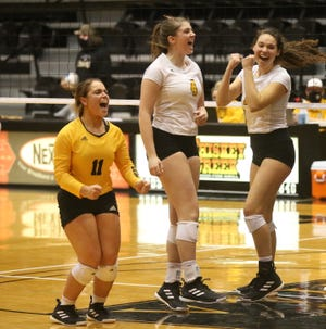 Fort Hays State's Jaden Daffer, left,  Carly Rodaway, middle, and Isabelle Reynolds celebrate a point on Sunday against Emporia State.