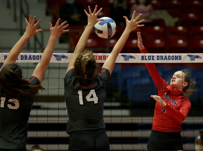 Hutchinson's Jenna Thorne (1) spikes the ball against Mineral Area's Kaylee Portell (13) and Mya Young (14) during their game in the Blue Dragon Volleyball Classic at the Sports Arena Saturday. Hutchinson defeated Mineral Area 25-21, 20-25, 20-25, 25-18, 15-7.