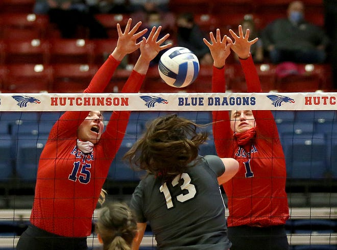 Hutchinson's Kristina Head (15) and Jenna Thorne (1) block the spike of Mineral Area's Kaylee Portell (13) during their game in the Blue Dragon Volleyball Classic at the Sports Arena Saturday. Hutchinson defeated Mineral Area 25-21, 20-25, 20-25, 25-18, 15-7.