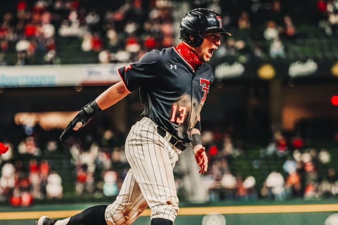 Texas Tech third baseman Cal Conley celebrates during the Red Raiders' season opener against Arkansas on Saturday night at Globe Life Field in Arlington. Conley drove in three runs, but Arkansas rallied for five in the ninth to beat the Red Raiders 13-9.