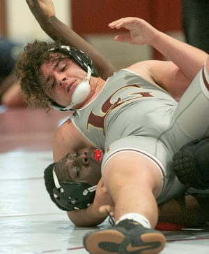 Lake Gibson's Connor Hackett, top, wrestles with King High School's Tyionte Sellers during their 182-pound championship match at the Class 2A, District 6 wrestling tournament.