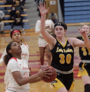 Nurjei (NJ) Weems of Moberly Area Community College women's basketball team keeps her eyes focused on the prize running in transition Saturday while Abby Turner of Three Rivers CC trails behind and raises her right arm to try and block Weems' shot. Weems scored four points during the Lady Greyhounds tough 57-54 home loss.
