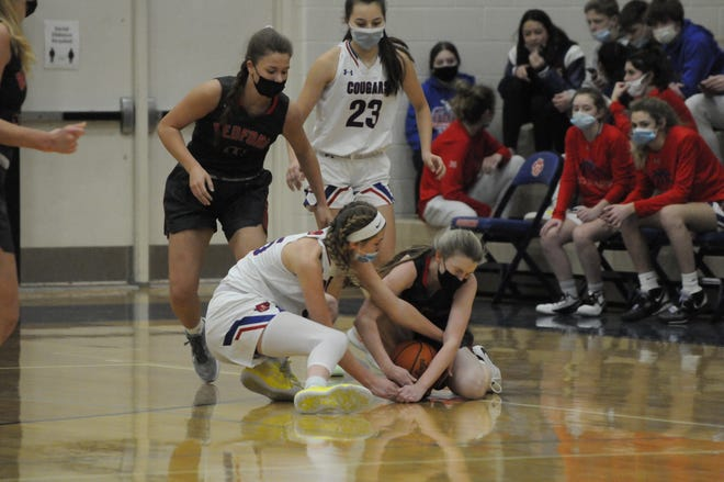 Bedford's Madison Weirich and Lenawee Christian's Bree Salenbien battle for a loose ball during Saturday's game.