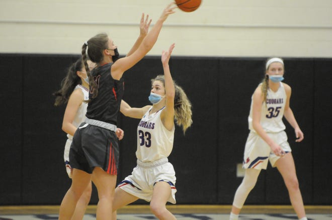 Bedford's Grace Ryan passes the ball while guarded by Lenawee Christian's Isabelle Kirkendall during Saturday's game.