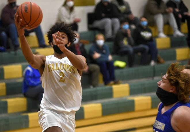 Cyrus Marks of St. Mary Catholic Central goes to the basket against  Jefferson's Alexander Mansfield last week. A third of the season already has gone by in high school basketball. [MONROE NEWS PHOTO BY TOM HAWLEY]
