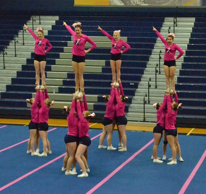 Airport's competitive cheerleading team copletes in its own Pink Out Competition last season.