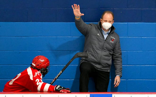 Hudson hockey coach Mike Nanartowich acknowledges a small crowd at North Star Ice Sports in Westboro after being recognized on his last day as head coach before a game against Westboro on Saturday. Nanartowich lead the Hawks for 31 years.