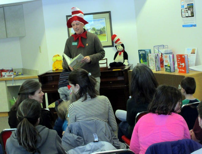 Hamilton Public Library director Travis Olivera reads a favorite Seuss story during the 2019 Seuss Saturday festivities. Although in-person celebrations won't happen this year, a Seuss Saturday weeklong scavenger hunt kicks off March 1 around Hamilton.