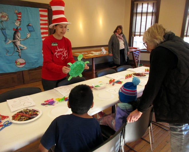 Jenni Larchar helps local youngsters celebrate Seuss Saturday last March with a turtle craft at the Colgate Bookstore in Hamilton. This year, Larchar will read the official Seuss Saturday proclamation and lead a livestreamed Seussi-cal sing-a-long at 10 a.m. March 6 on her Jenni's Music Facebook page.