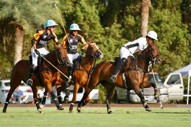 MVP Pablo MacDonough (right) of Richard Mille plays the near side shot with Adolfo and Poroto Cambiaso of Hawaii Life defending during Saturday's season-opening All-Star Challenge at Grand Champions Polo Club in Wellington.