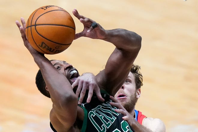 Celtics forward Tristan Thompson is fouled by Pelicans forward Nicolo Melli as he drives to the basket in the second half Sunday in New Orleans.
