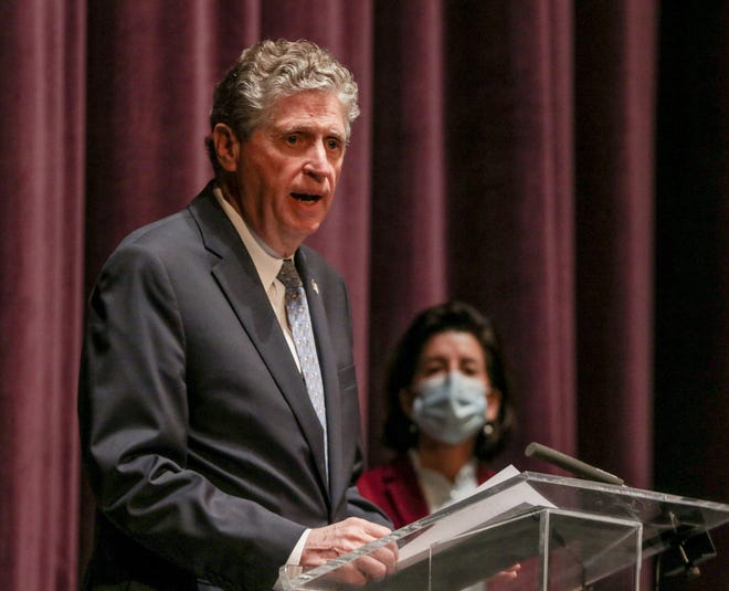 Dan McKee, who will soon become Rhode Island's next governor, says the first issue he faces is the COVID-19 vaccination rollout. Here, he speaks at a recent COVID-19 briefing, with outgoing Gov. Gina Raimondo in the background.
