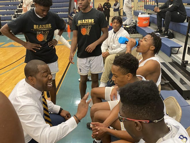 Bethesda basketball coach Clevan Thompson with his Blazers squad last season.