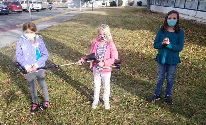 Grenada Elementary third-graders Paisley, Audrey, and Katelyn assisted in searching for a missing item a staff member lost. Katelyn eventually located the missing air buds.