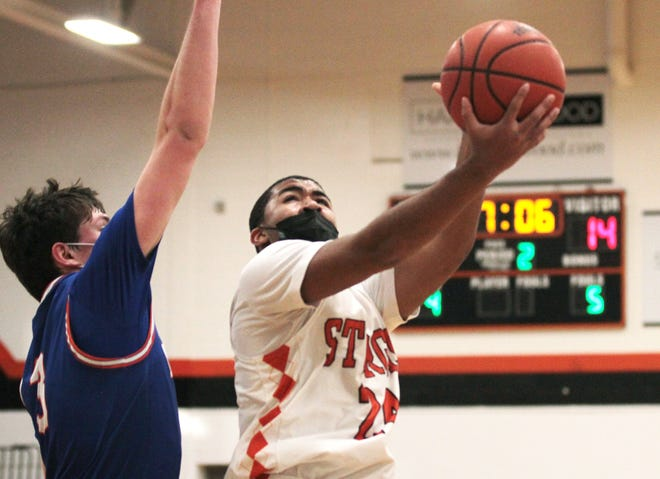 Sturgis' Jacob Thompson glides in for a layup against Edwardsburg in prep hoops action on Saturday afternoon.