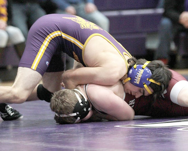 Blake Platter works to move his opponent on the mat before pinning him on Saturday afternoon.